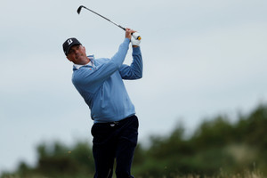 Kuchar leads in clubhouse as challengers face elements